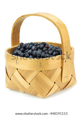 Forest blueberries in basket on a white background