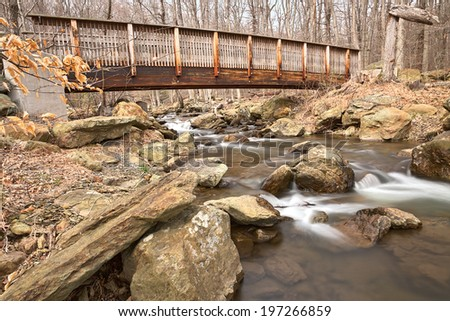 Forest bridge & water stream from Cunningham State Falls Park in Maryland, USA. HDR composite from multiple exposures.