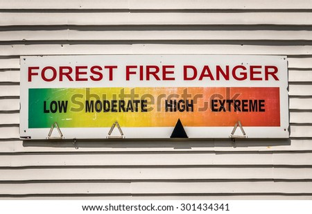 Forest Fire Danger Warning Sign At A Fire Station - stock photo