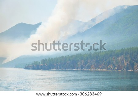 Forest fire on western shore of Lake Baikal in Sandy Bay area