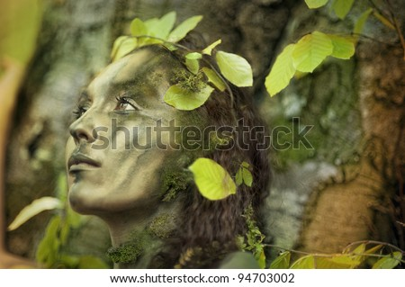 Forest girl in front of a beech-tree