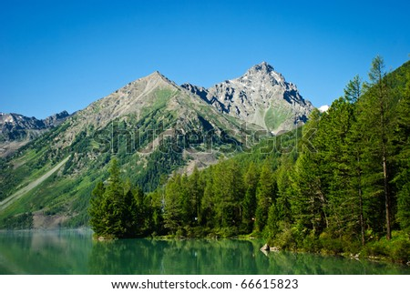 Forest lake, mountains, wild landscape, Ak-kem river, Altai, Russia - stock photo