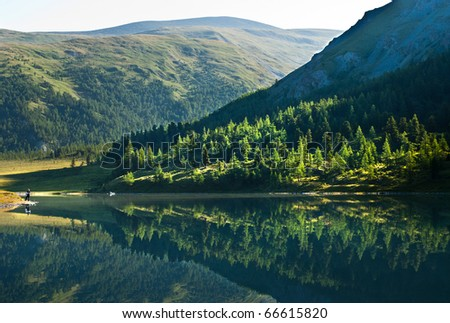 Forest lake, wild landscape, Ak-kem river, Altai, Russia - stock photo