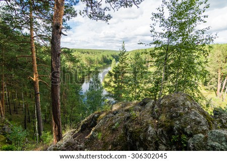 forest landscape with river and rocky coast, Russia, Ural - stock photo