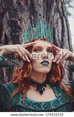 forest nymph in green dress  - stock photo