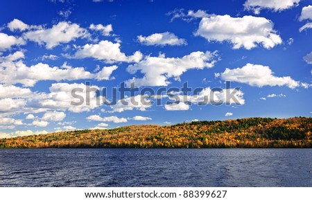 Forest of colorful autumn trees with lake in Algonquin Park, Canada - stock photo