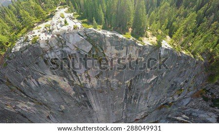 Forest on top of rocky mountain in Yosemite National Park at autumn sunny day. Aerial view - stock photo