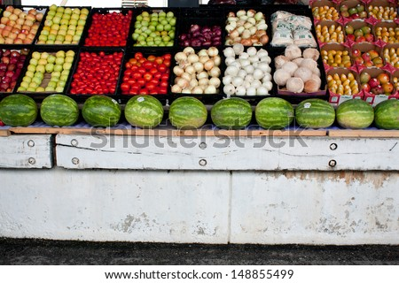 FOREST PARK, GA - JULY 27:  Brightly colored fruits and vegetables are displayed as part of the Georgia Grown Farmers Showcase at the Atlanta Farmers Market, on July 27, 2013 in Forest Park, GA.    - stock photo