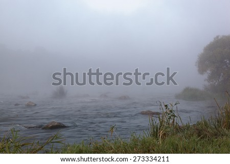Forest River rapids morning fog at sunrise. - stock photo