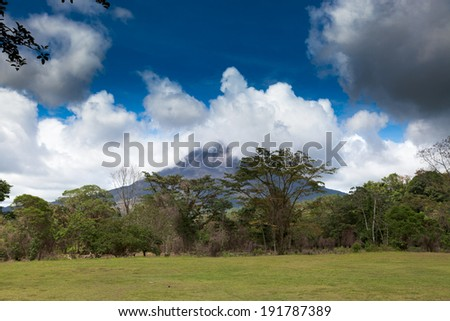 Forest with a volcano in the background, Costa Rica - stock photo