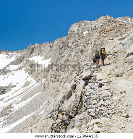 Forester Pass, Sierra Nevada - Hikers on their way up to Forester Pass crossing from Sequoia to Kings Canyon National Park, California, USA. - stock photo