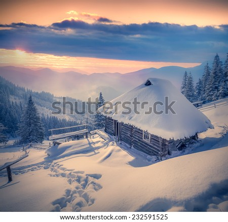 Forester's hut covered with snow in the mountains at sunrise. Retro style. - stock photo