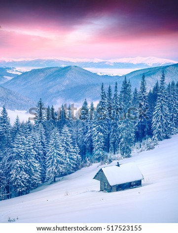 Forester's hut in the snowy mountain forest. Colorful winter sunrise in Carpathians, Happy New Year celebration concept. Artistic style post processed photo.