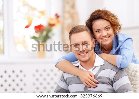 Forever together. Cheerful loving vivacious young couple embracing and spending agreeable time together - stock photo