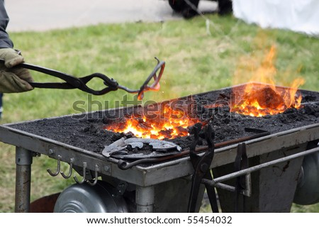 Forge with hot flaring coal - stock photo