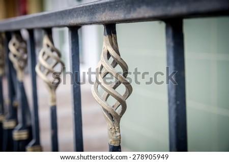 Forged decorative fence - stock photo