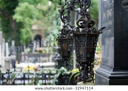Forged lanterns on tombstone - stock photo