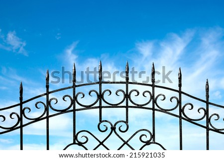 forged metal fence against the sky - stock photo