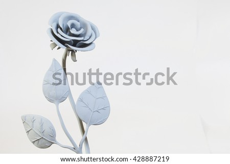 Forged metal products. Flowers and leaves are forged and coated with a primer. design elements. On a white background. - stock photo