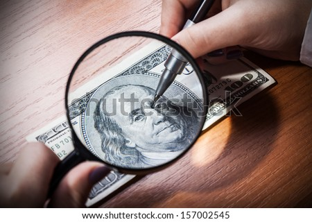 forgery or restoration of banknotes, close-up, financial background - stock photo