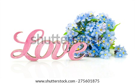 """Forget-me-not flowers and word """"love"""" isolated on white - stock photo"""