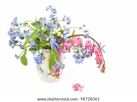 Forget-me-nots and bleeding hearts in a spring bouquet. - stock photo