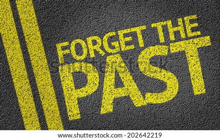 Forget the past written on the road - stock photo