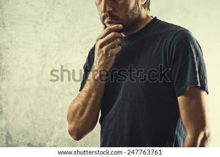 Forgetful Man Having Problems Remembering Something Important, Hand on Chin. - stock photo