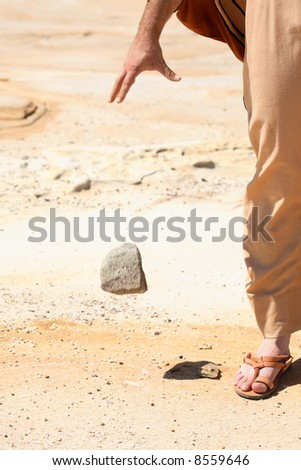 Forgiveness - its all in my hands.  Symbolic concept of man dropping a stone from his hand.   Concept, peace, mercy, pardon, forgiveness, compassion. - stock photo