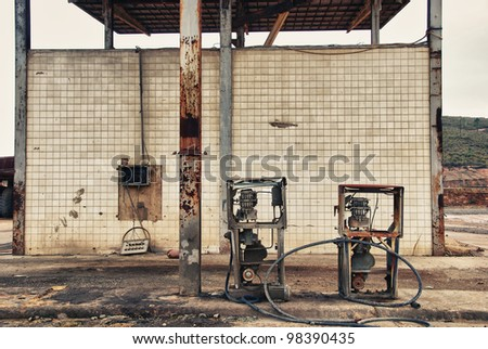 Forgotte worlds - old pumps. Abandoned fuel pumps Tharsis mines, Spain - stock photo