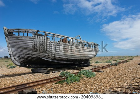 forgotten fishing boat at Dungeness. - stock photo
