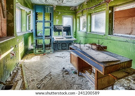 Forgotten place of work in the old building - stock photo