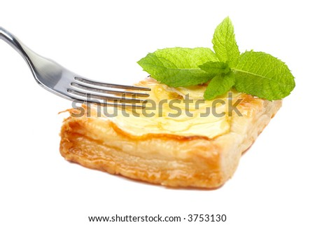 Fork and apple tart with leaves of mint on a dish. Soft shadow, isolated on white background. Shallow DOF - stock photo