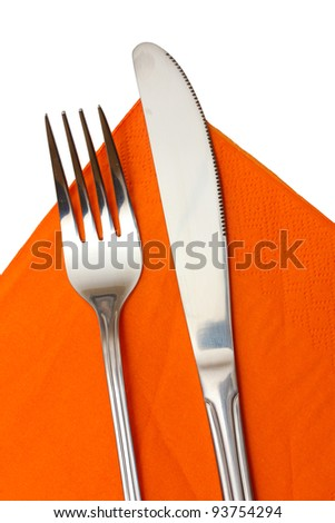 Fork and knife in a orange cloth isolated on white - stock photo