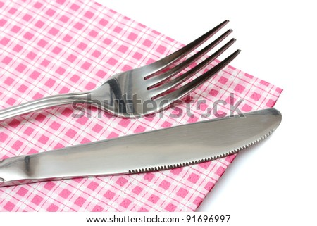 Fork and knife in a plaid cloth  isolated on white - stock photo
