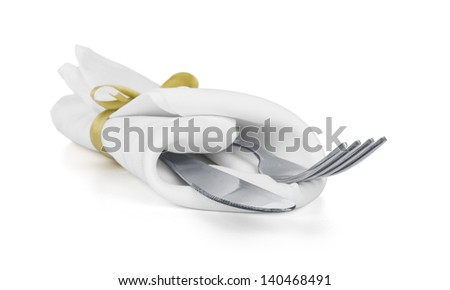 Fork and knife in a white napkin with a bow isolated on white - stock photo