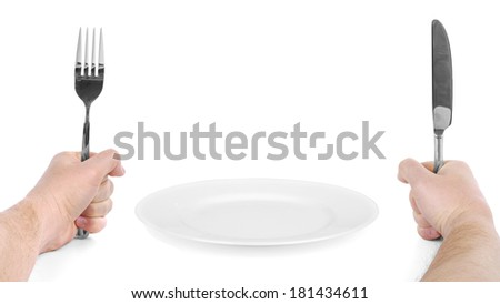 Fork and knife in hands with plate, isolated on white - stock photo