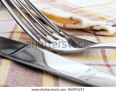 Fork and knife on a napkin - stock photo