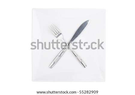 Fork and knife on a squared plate isolated