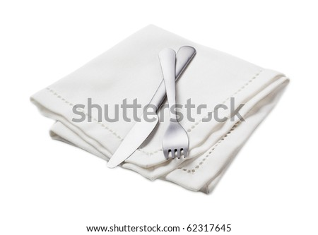 Fork and knife on a white napkin - stock photo