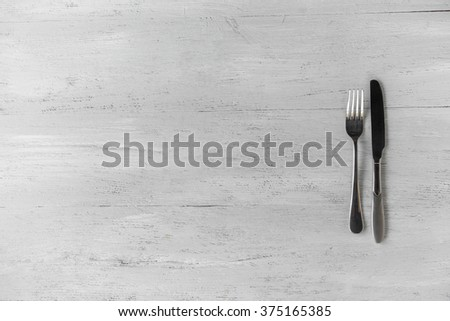 fork and knife on the table - stock photo