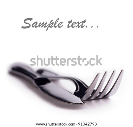 Fork and knife on the white background with place for text - stock photo