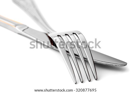 Fork and knife on white background close-up, isolated - stock photo