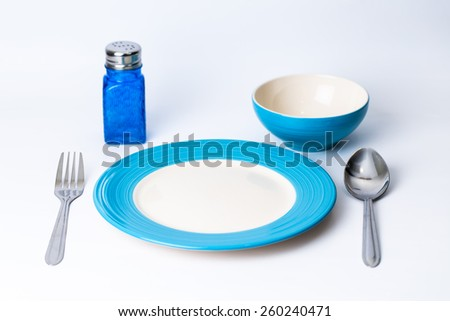 Fork and plate on table isolated. - stock photo