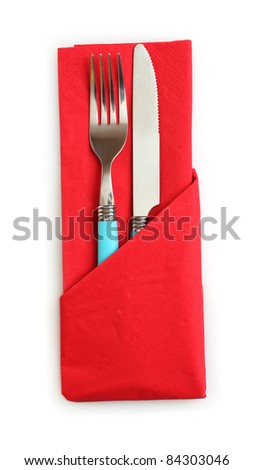 fork and spoon in red cloth, isolated on white - stock photo