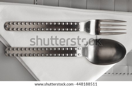 fork and spoon isolated on table - stock photo