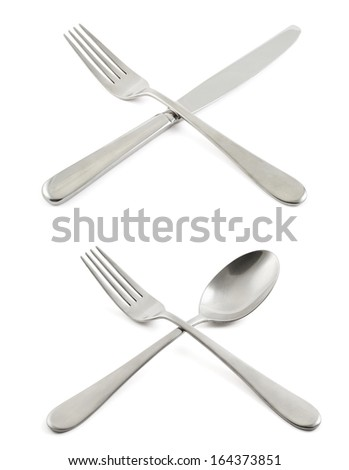 Fork crossed with a knife and spoon compositions isolated over white background