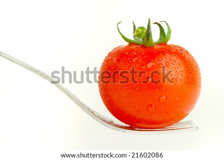 fork holding a tomato