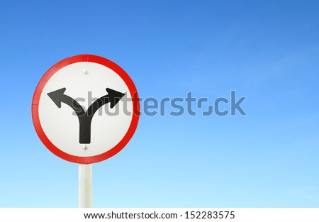fork junction traffic sign with blue sky blank for text - stock photo