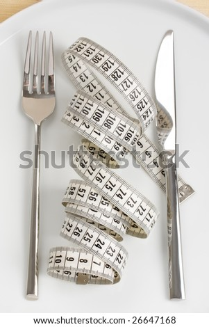 fork, knife and measuring tape